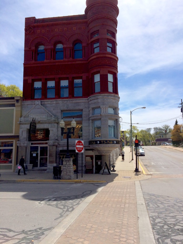Street view of Ramsdell Building and TJ's Pub at Manistee, Michigan