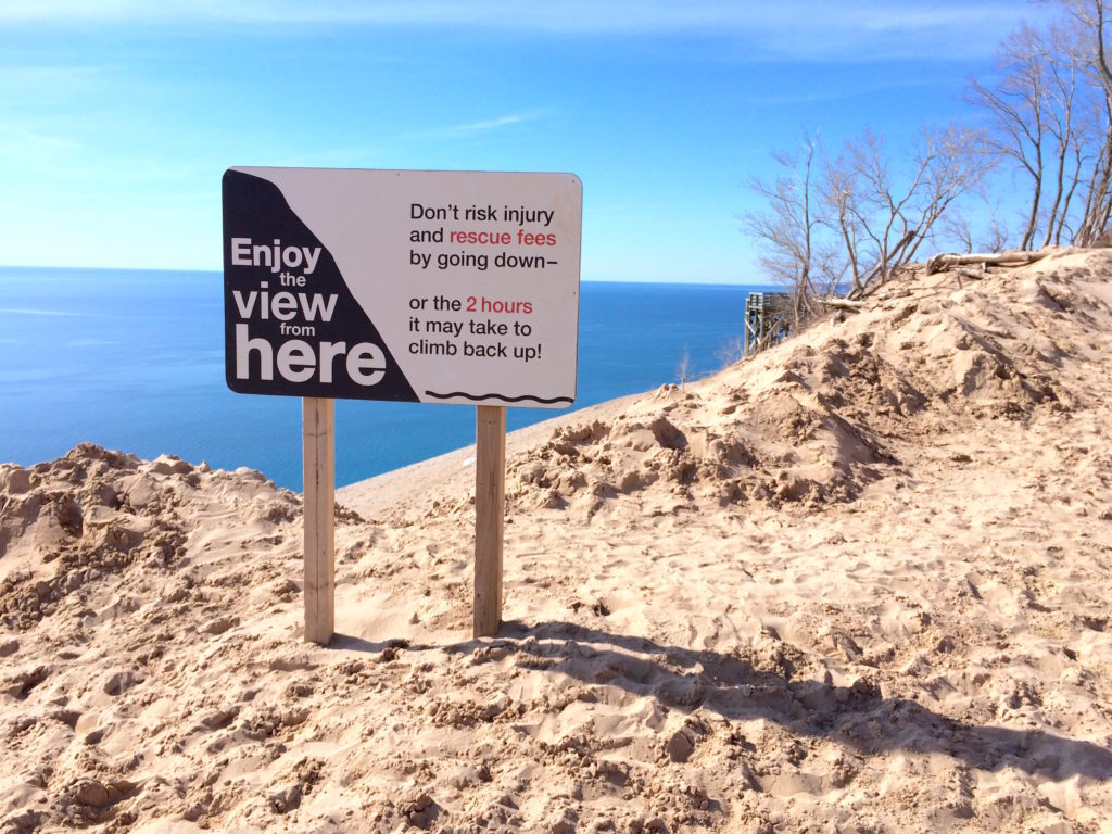Warning sign at top of dunes at Sleeping Bear Dunes National Lakeshore Michigan