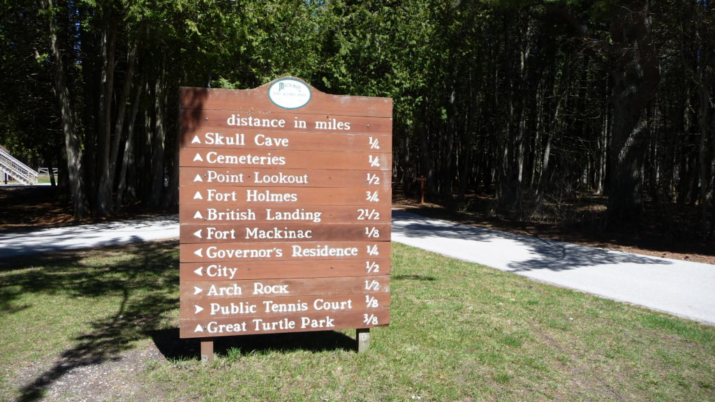 Sign showing paths and distance of various trails on Mackinac Island