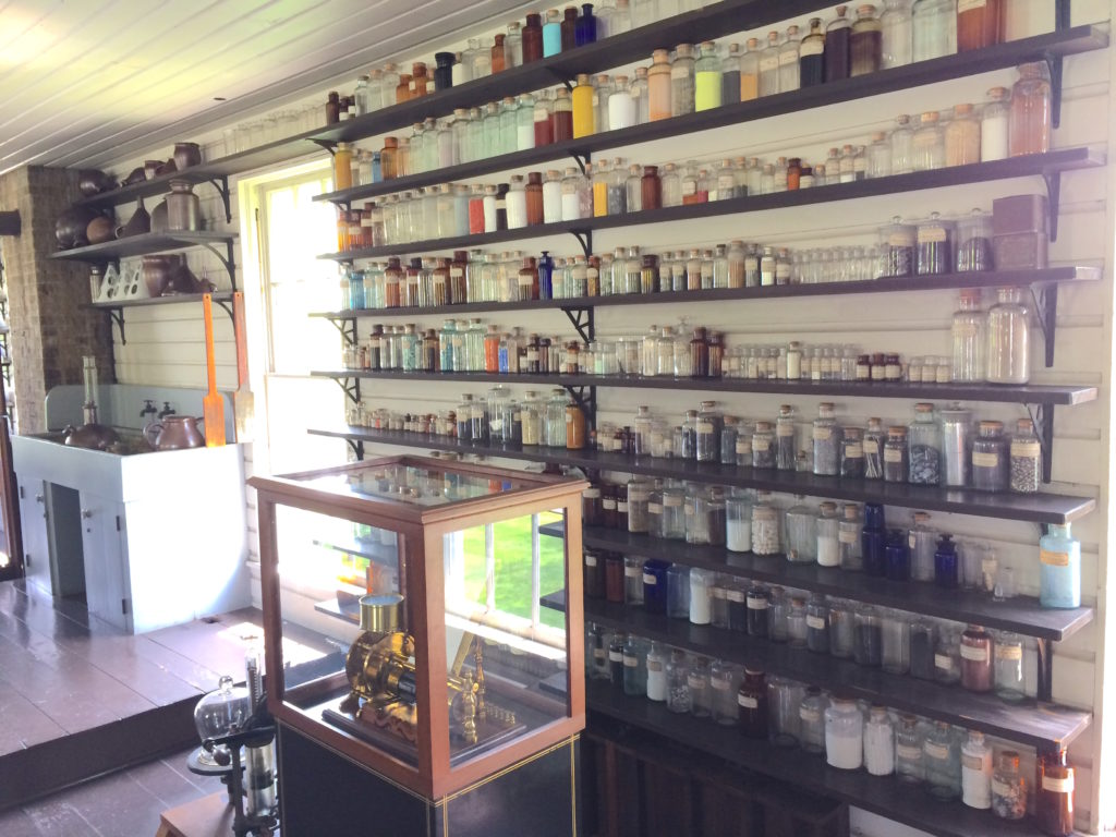 Edison's lab with many specimen bottles on the walls