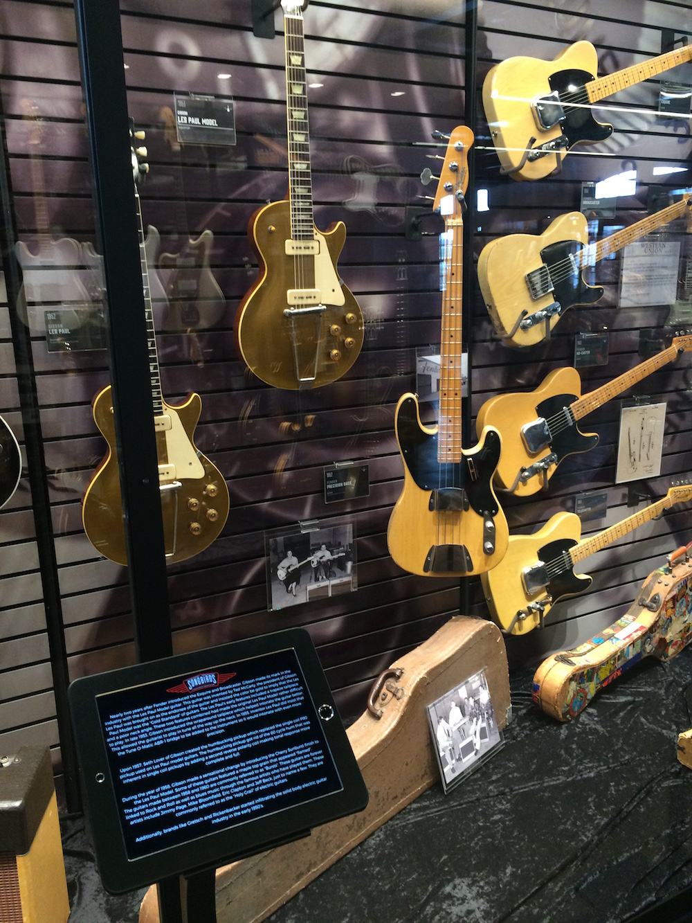 iPads teach you about the guitars in the displays
