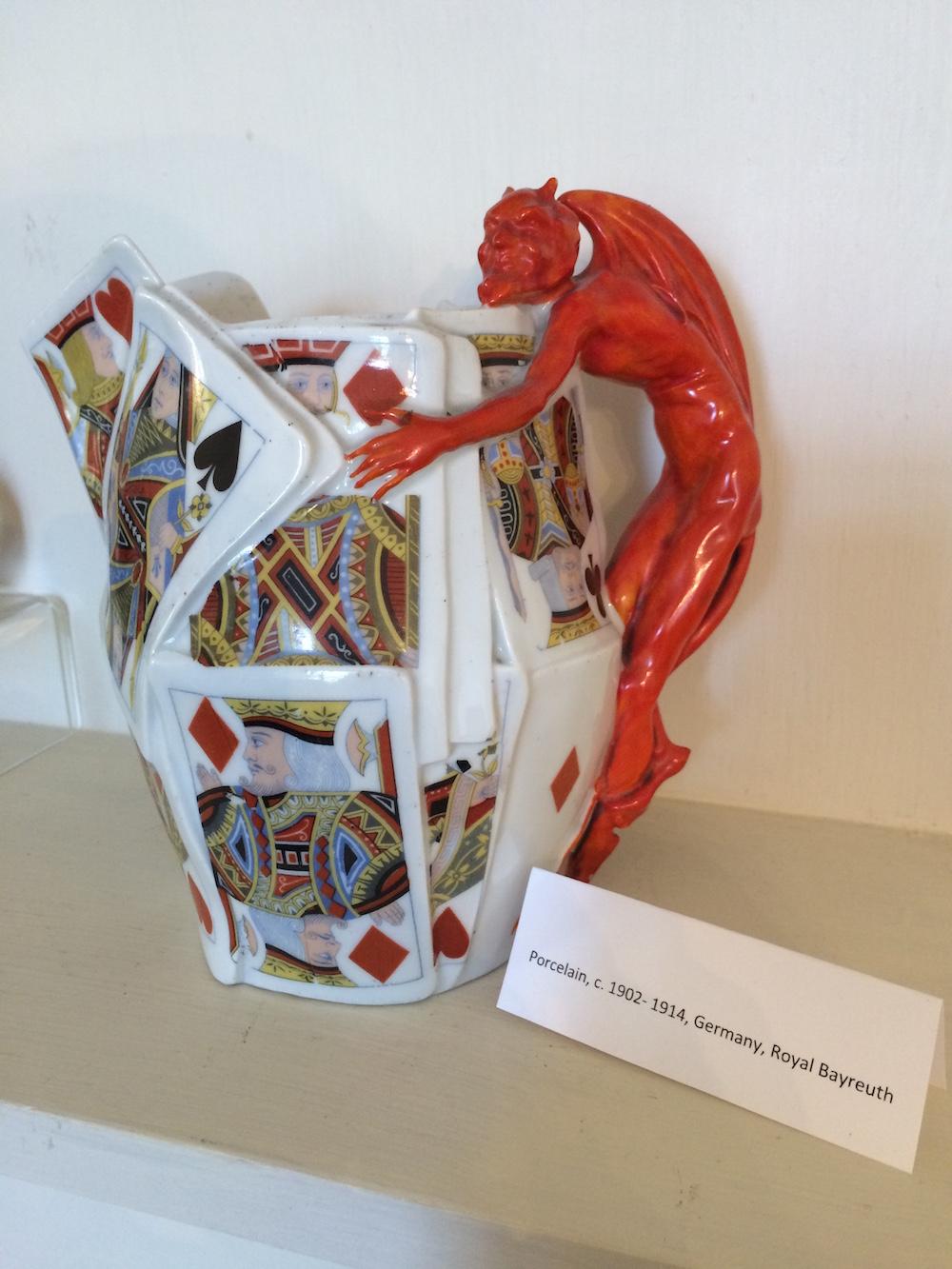 porcelain cup with devil as handle