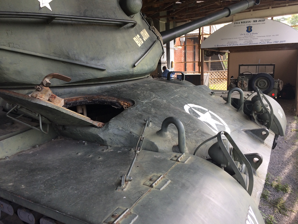 """Tank with Bantam """"Jeep"""" in the background"""